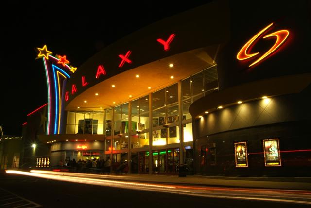 Galaxy Theatre illuminated at night.